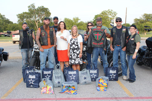 Infidels Motorcycle Club donates school supplies to Finley ...