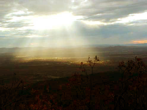 A burst of light illuminates the valley below. photo by Tammy Skidmore Rich